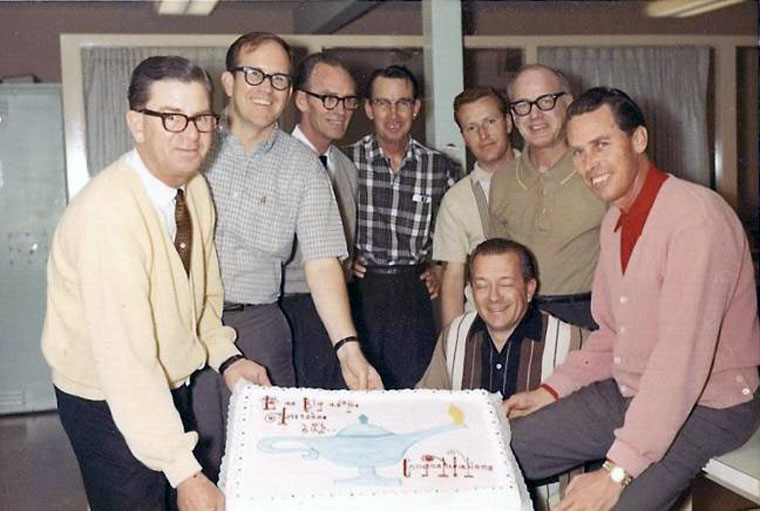 Shown clockwise are Hand Schutte, Bob Gilbert (not designers), Jack Larson Sr., Hermon Boernge, Brian Leming, Kermit Wayne, Ray Larson and Ben Mitchem (kneeling). Photograph courtesy of Brian Leming & YESCO